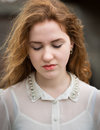 Beautiful Ginger Teenage Girl Looking Down Royalty Free Stock Photo