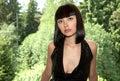 Beautiful girl against the foliage shined Royalty Free Stock Photo
