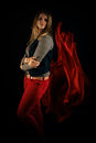Beautiful girl against red fabric in the dark with long blond hair Stock Images