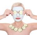 Beautiful girl applying facial mask of cucumber Stock Photo