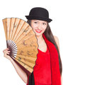 Beautiful girl asian in black hat with a fan mixed race caucasian Stock Photography