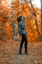Beautiful girl in the autumn park gray Stock Image
