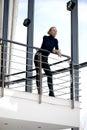 Beautiful girl on a balcony Royalty Free Stock Photo