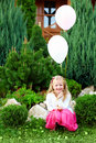 Beautiful girl with balloons on green lawn Royalty Free Stock Images