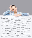 Beautiful girl with a banner of world's different languages Royalty Free Stock Photo
