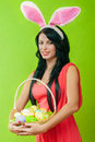 Beautiful girl with a basket of easter eggs i in bunny suit Royalty Free Stock Photo
