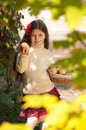Beautiful girl with basket of ripe apples Royalty Free Stock Photography