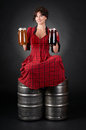 Beautiful girl in the beer kegs Royalty Free Stock Photography