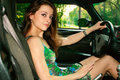 Beautiful girl behind the wheel in the sport car Royalty Free Stock Photo