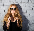 Beautiful girl with big black glasses Royalty Free Stock Image