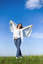 Beautiful girl with big piece of cloth outdoor portrait under the blue sky Stock Image