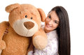 Beautiful girl with a big teddy bear happy brunette playing Royalty Free Stock Photos