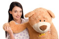 Beautiful girl with a big teddy bear happy brunette playing Stock Photos