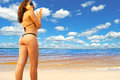 Beautiful girl in a bikini on the beach sexy sunny Royalty Free Stock Image
