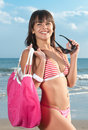 Beautiful girl with bikini at the seaside blue Stock Photography