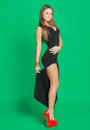 Beautiful girl in a black dress on green background Royalty Free Stock Image