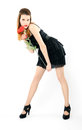 Beautiful girl in a black dress with poppy Royalty Free Stock Photo