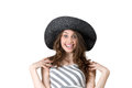 Beautiful girl in black hat laughing with delight a fashionable Stock Photo