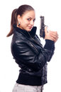 Beautiful girl in black leather jacket and beretta Stock Photos