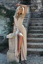 Beautiful girl with blond hair in beige dress Royalty Free Stock Photos