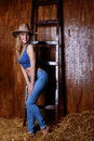 Beautiful girl with blond hair wearing cowboy hat Royalty Free Stock Photo