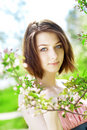 image photo : Beautiful girl among the blooming trees