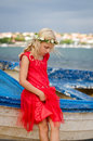 Beautiful girl and boat Royalty Free Stock Photo