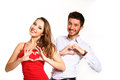 Beautiful girl and boy forming heart with her hands isolated on Royalty Free Stock Photography