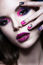 Beautiful girl with bright creative fashion makeup and colorful nail polish. Art beauty design. Royalty Free Stock Photo