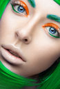 Beautiful girl in a bright green wig in the style of cosplay and creative makeup. Beauty face. Art image.
