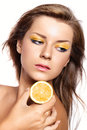 Beautiful girl with a bright lemon-colored make-up Stock Photos