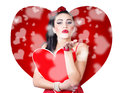 Beautiful girl in a bright love romance sending kiss on creative hearts background Royalty Free Stock Photo