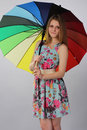 Beautiful girl with a bright umbrella Royalty Free Stock Photo
