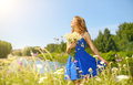 Beautiful girl with bunch of camomiles Royalty Free Stock Photo