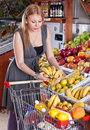 The beautiful girl buys fruit Royalty Free Stock Photography