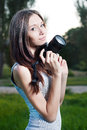 Beautiful girl with camera outdoor portrait of a young woman Royalty Free Stock Images