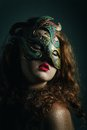 Beautiful girl in carnival mask with long curly hair masquerade holidays Stock Photos