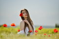 Beautiful girl on cereal field in spring Royalty Free Stock Photo