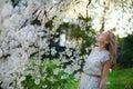 Beautiful girl in cherry blossom garden