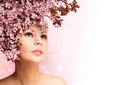 Beautiful Girl With Cherry Blossom isolated on white. Beauty Royalty Free Stock Photo