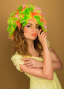 Beautiful girl in a color wig and beautiful up make up on the background Royalty Free Stock Photo