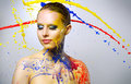 Beautiful girl and colorful paint splashes on light background Stock Photo