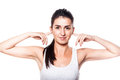 Beautiful girl covering her ears by hands because of loudness on white Royalty Free Stock Image