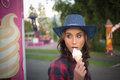 Beautiful girl in a cowboy hat eating ice cream Royalty Free Stock Photo