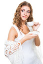 Beautiful girl with cup in knitted shawl on isolated white young drinking morning coffee background Royalty Free Stock Photos