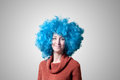 Beautiful girl with curly blue wig and turtleneck on colorful background Stock Photography