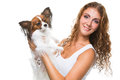 Beautiful girl with cute papillon dog on isolated white young background Royalty Free Stock Images