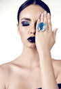 Beautiful girl with dark hair with bright extravagant makeup and bijou Royalty Free Stock Photo