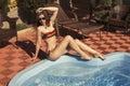 Beautiful girl with dark hair in colorful bikini Royalty Free Stock Photo