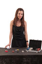 Beautiful girl dealer behind a table for game in poker on white background Royalty Free Stock Images